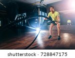 man with battle ropes exercise... | Shutterstock . vector #728847175