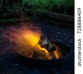 late evening. the fire burns in ... | Shutterstock . vector #728886409