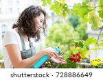 view of a young woman watering... | Shutterstock . vector #728886649
