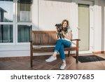 smiling teenage girl sitting on ... | Shutterstock . vector #728907685