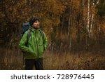 mature backpacker in an autumn... | Shutterstock . vector #728976445
