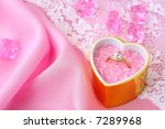 wedding / valentine's / background Ring with a brilliant in a gift with love - stock photo