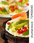 Tostadas with shrimps and marrow salad. - stock photo