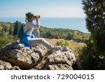 a blond woman tourist looking... | Shutterstock . vector #729004015