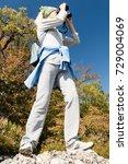 a blond woman tourist looking... | Shutterstock . vector #729004069