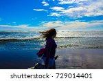 girl by the ocean   Shutterstock . vector #729014401