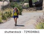 A Blonde Female Hiker Wearing A ...