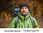 mature backpacker in an autumn... | Shutterstock . vector #729072679