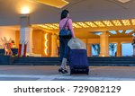 young woman with suitcase... | Shutterstock . vector #729082129