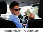 taxi driver gives change to a... | Shutterstock . vector #729086035