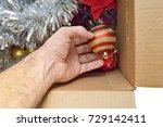 man's hand unboxing christmas... | Shutterstock . vector #729142411