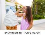 young woman with ice cream cone ... | Shutterstock . vector #729170704