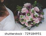 bride holding her boho wedding ... | Shutterstock . vector #729184951