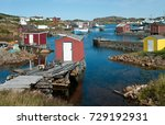 Small photo of Newfoundland Fishing Village: Fishing shanties sit on rustic wooden piers and rock jetties that extend into a small harbor on the north coast of Newfoundland.