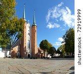Oliwa Cathedral in the sunshine. Gdansk, Poland. - stock photo