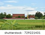 Small photo of The beauty of Wat Dong Yah is surrounded by fields in the evening. Recorded on October 6, 2017 Location Chehom District, Lampang Province, Thailand.
