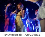 dancing and drinking in the... | Shutterstock . vector #729224011