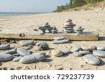 three small inukshuks  sit on a ...   Shutterstock . vector #729237739