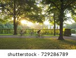 a family bikes rides in the park | Shutterstock . vector #729286789