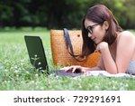 smiling girl with glasses lying ... | Shutterstock . vector #729291691