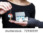 A conceptual image of someone receiving their key to their new home. - stock photo