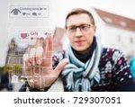 man traveler points a finger on ... | Shutterstock . vector #729307051