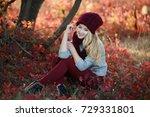 attractive blonde in hat with... | Shutterstock . vector #729331801