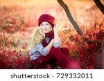 attractive blonde in hat with... | Shutterstock . vector #729332011