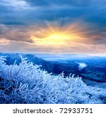 Winter evening scene in mountains - stock photo