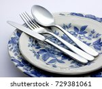 silver cutlery on decorated...