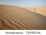 Beautifully patterned waves of sand displaying repetition in the Thar desert in Khuri, Rajasthan, India - stock photo