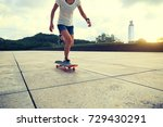 young woman skateboarder riding ... | Shutterstock . vector #729430291