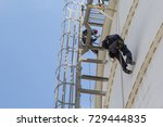 male two worker rope access ... | Shutterstock . vector #729444835