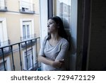 young sad and desperate latin... | Shutterstock . vector #729472129