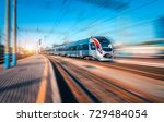 high speed train in motion at... | Shutterstock . vector #729484054