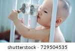 a toddler boy trying to unlock... | Shutterstock . vector #729504535