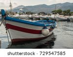 the fishing boat is white and... | Shutterstock . vector #729547585