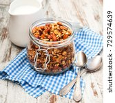 homemade baked granola in a... | Shutterstock . vector #729574639