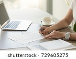 businesswoman signing paper at... | Shutterstock . vector #729605275