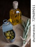 oil bottle with olives in dark...   Shutterstock . vector #729689011