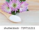 white sugar in spoon and pink... | Shutterstock . vector #729711211
