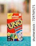 Small photo of Mattel Uno Junior card game in a red box on table in soft focus on October 2017 in Poznan, Poland