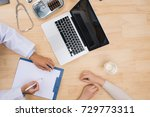 doctor sitting at office desk...   Shutterstock . vector #729773311
