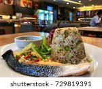 Small photo of A la carte superfood menu , large piece of spicy and sour salmon fish with Quinoa fried brown rice