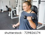 fat girl in a gym | Shutterstock . vector #729826174