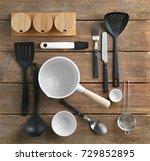 kitchen utensils on wooden