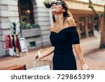 asian woman with shopping bags... | Shutterstock . vector #729865399