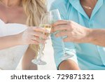 couple holds two glasses with