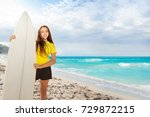 Girl With Surfing Board On The...