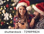 young couple toasts in new year'... | Shutterstock . vector #729899824